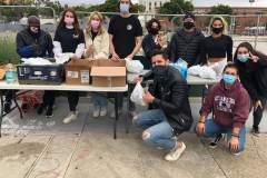 SDSU's Helping the Homeless passing food and care packages to the homeless downtown