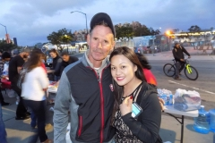 Tammy helps a homeless man at the Streets of Hope San Diego Easter event.