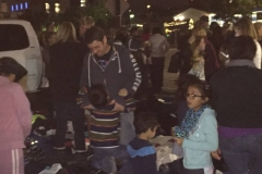 Children volunteers of the Streets of Hope help with their parents pass out clothing to the homeless.