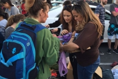 During Easter Michelle and Suzy helping Rachael, who is homeless, find her size with the clothing.