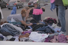 A few homeless woman sort through the many clothing donations this Memorial Day.