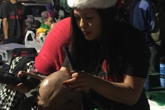 Part 4 - Tammy cutting a homeless man's hair during the Streets of Hope Christmas event.