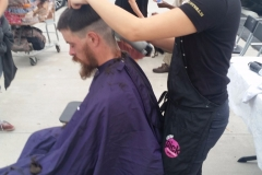 Laura cutting San Diego homeless man's hair