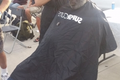 Laura cuts Milton's hair - Streets of Hope San Diego.