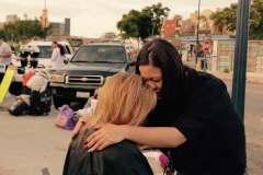 Tammy prays for a homeless woman after cutting her hair on Memorial Day.